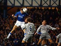 Fotball: Rangers v Paris St. Germain, Ibrox  Stadium Glasgow, UEFA Cup 3rd round first leg match<br />Pic Ian Stewart, Thursday November 22nd. 2001.<br /><br />Tore Andre Flo heads past P.S.G defender Dehu<br /><br />Foto: Ian Stewart, Digitalsport