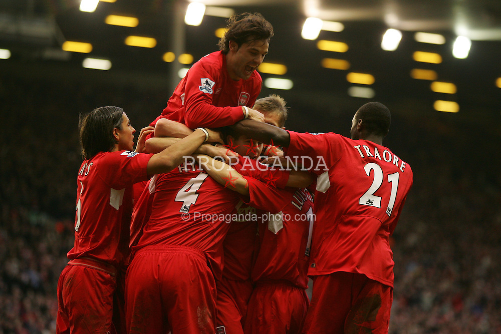 LIVERPOOL, ENGLAND - SATURDAY FEBRUARY 5th 2005: Liverpool's Sami Hyypia (hidden) celebrates scoring the second goal with his team mates during the Premiership against Fulham match at Anfield. (Pic by David Rawcliffe/Propaganda)