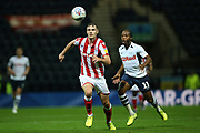 Stoke City defender Liam Lindsay (5) beats Preston North End midfielder Daniel Johnson (11) to the ball during the EFL Sky Bet Championship match between Preston North End and Stoke City at Deepdale, Preston, England on 21 August 2019.