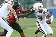 Louisville Cardinals linebacker C.J. Avery (9) grabs the face mask of Mississippi State Bulldogs wide receiver JaVonta Payton (4) during a game between Mississippi State and University of Louisville in Nashville, TN December 30, 2019