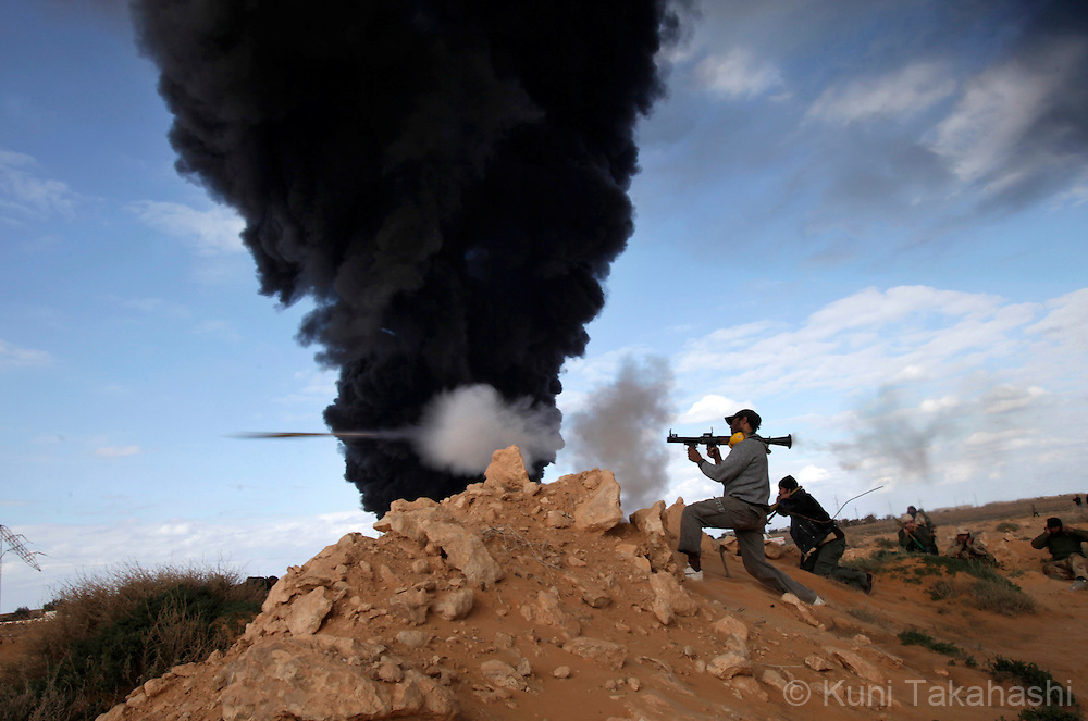 A rebel soldier against Col. Muammar Gaddafi fires RPG at frontline near Ras Lanuf on March 9, 2011. The government military and rebels kept fighting for taking control of the town for the last two days. .Photo by Kuni Takahashi