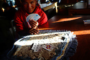 Nepali guide playing cards, Gorak Shepp teahouse,Nepal 2007. Nepal 2007. Everest Base Camp