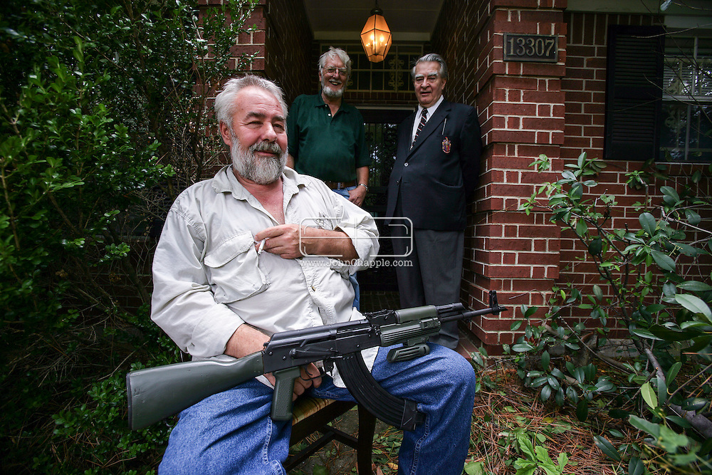 24th September 2005, Houston, Texas. 'Dad's Army'. Michael J. Von Trytek with his AK-47 and two British friends, Rob Lucas-Dean and Neville Gary Leach. The trio were guarding their property from looters, after Hurricane Rita hit Houston.  .Photo © John Chapple / www.JohnChapple.com..THIS COPYRIGHTED IMAGE MUST NOT BE USED WITHOUT PERMISSION