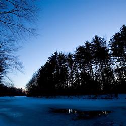 Dusk over the frozen Ashuelot River in Keene, New Hampshire.  Winter.