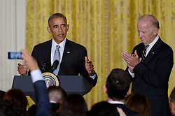 October 12, 2016 - Washington, District of Columbia, United States of America - United States President Barack Obama (L) and Vice President Joe Biden attend a reception for Hispanic Heritage Month in the East Room of the White House on October 12, 2016 in Washington, DC. .Credit: Olivier Douliery / Pool via CNP (Credit Image: © Olivier Douliery/CNP via ZUMA Wire)