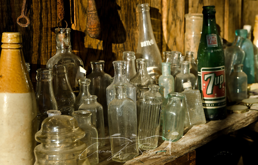 Antique bottles sit on a shelf at Booker Hardware & Cutlery Oct. 10, 2011 in Holly Springs, Miss. The store was established in 1937. (Photo by Carmen K. Sisson/Cloudybright)