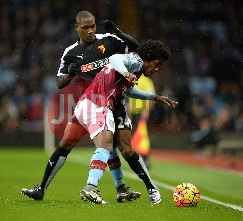 Carlos Sanchez of Aston Villa battles for the ball with Odion Ighalo of Watford - Mandatory byline: Alex James/JMP - 28/11/2015 - Football- Aston Villa  - Birmingham, Watford  - Aston Villa v Watford - Barclays Premiership