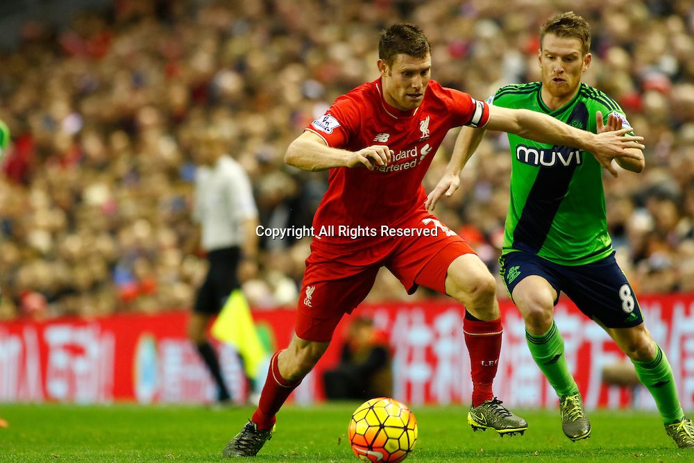 25.10.2015. Anfield, Liverpool, England. Barclays Premier League. Liverpool versus Southampton. Liverpool skipper James Milner holds off the challenge of Southampton's Steven Davis.
