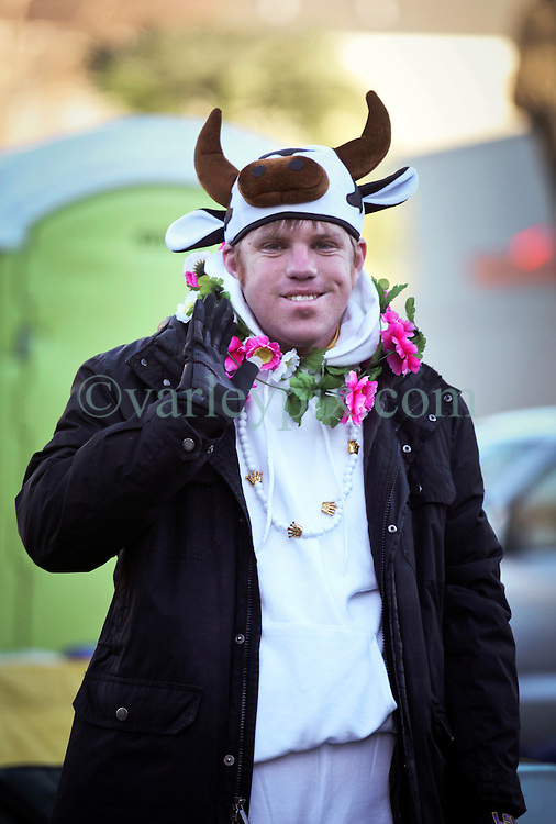 09 February 2016. New Orleans, Louisiana.<br /> Mardi Gras Day. Waiting for the parade. A man in costume awaits the main Mardi Gras Parades of Zulu and Rex on St Charles Avenue.<br /> Photo©; Charlie Varley/varleypix.com