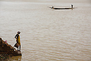 Woman collecting water from the river. At the confluence of the Niger and the Bani rivers, between Timbuktu and Segou, Mopti is the second largest city in Mali, and the hub for commerce and tourism in this west-african landlocked country.