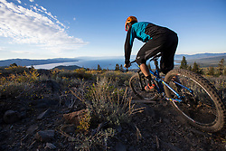 Casey Coffman rides the Tahoe Rim Trail on an early autumn sunrise