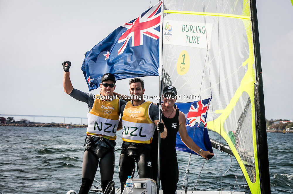 New Zealand sailors Alex Maloney with Peter Burling and Blair Tuke celebrate.<br /> The Rio 2016 Olympic Sailing Competition features 380 athletes from 66 nations, in 274 boats racing across ten Olympic disciplines. Racing runs from Monday 8 August through to Thursday 18 August 2016 with 217 male and 163 female sailors racing out of Marina da Gloria in Rio de Janeiro, Brazil. Sailing made its Olympic debut in 1900 and has been a mainstay at every Olympic Games since 1908. For more information or requests please contact Daniel Smith at World Sailing on marketing@sailing.org or phone +44 (0) 7771 542 131.
