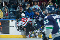 KELOWNA, CANADA - APRIL 30: Keegan Kolesar #28 of the Seattle Thunderbirds hits Devante Stephens #21 of the Kelowna Rockets from behind and receives a 5 minute major and a game misconduct penalty on April 30, 2017 at Prospera Place in Kelowna, British Columbia, Canada.  (Photo by Marissa Baecker/Shoot the Breeze)  *** Local Caption ***