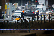 Brussels 23 March 2016 a corps of a victim is being evacuated from subway entrance Maalbeek on a bed
