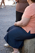 obese elderly woman sitting to rest