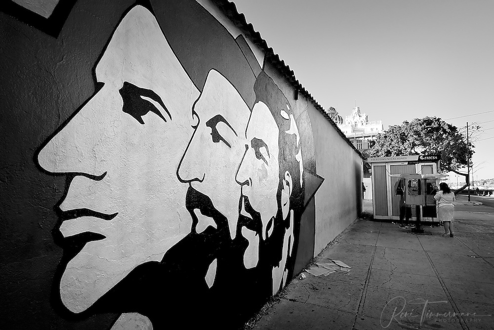 """A street painting of the Three Heroes (""""Tres Heroicos"""")."""