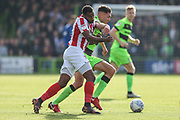 Forest Green Rovers Paul Digby(20) and Cheltenham Town's Tyrone Barnett(29) during the EFL Sky Bet League 2 match between Forest Green Rovers and Cheltenham Town at the New Lawn, Forest Green, United Kingdom on 20 October 2018.