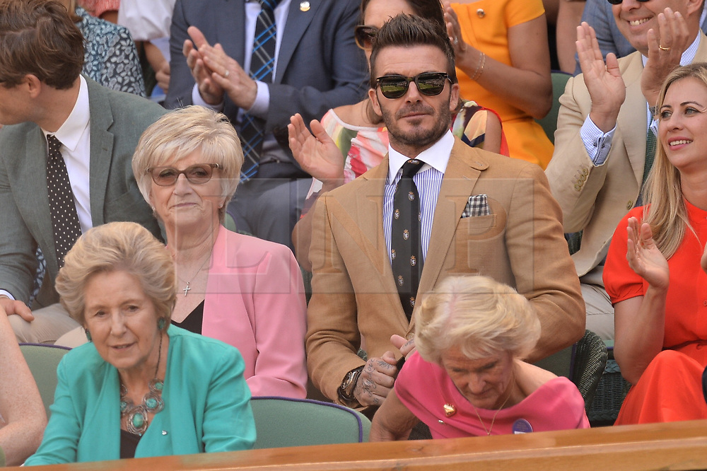 © Licensed to London News Pictures. 11/07/2019. London, UK. David Beckham and mother Sandra watch centre court tennis in the royal box on Day 10 of the Wimbledon Tennis Championships 2019 held at the All England Lawn Tennis and Croquet Club. Photo credit: Ray Tang/LNP