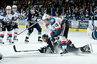 KELOWNA, CANADA, FEBRUARY 8: Brendan Rouse #16 of the Seattle Thunderbirds is checked by Colton Sissons #15 of the Kelowna Rockets as the Seattle Thunderbirds visit the Kelowna Rockets on February 8, 2012 at Prospera Place in Kelowna, British Columbia, Canada (Photo by Marissa Baecker/www.shootthebreeze.ca) *** Local Caption ***