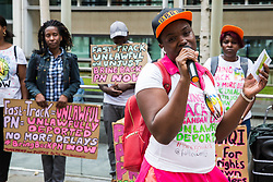 London, UK. 10 July, 2019. A Movement for Justice campaigner addresses a protest outside the Home Office against the government department's decision to try to block the return to the UK of PN, a Ugandan lesbian removed from the UK using the now unlawful fast track procedure in 2013 but who the High Court ordered on 24th June must be returned to the UK by the Home Office after the handling of her case was ruled to be 'procedurally unfair'.