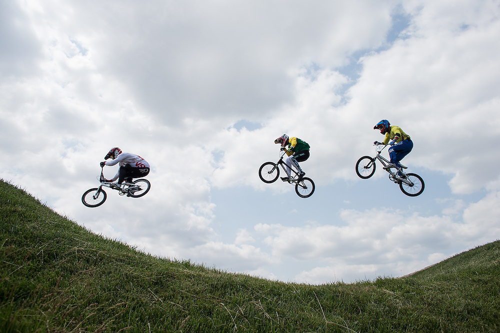 Riders clear a jump during the Motos during the BMX competitionat the 2015 Pan American Games in Toronto, Canada July 11,  2015.  AFP PHOTO/GEOFF ROBINS