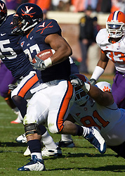 Clemson defensive tackle Rashaad Jackson (91) tackles Virginia running back Cedric Peerman (37) for a loss.  The Clemson Tigers defeated the Virginia Cavaliers 13-3 in NCAA Division 1 football at Scott Stadium on the Grounds of the University of Virginia in Charlottesville, VA on November 22, 2008.