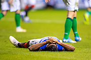 Alfredo Morelos (#20) of Rangers FC lies on the ground after missing a golden chance during the Ladbrokes Scottish Premiership match between Hibernian and Rangers at Easter Road, Edinburgh, Scotland on 19 December 2018.