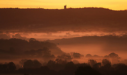 © Licensed to London News Pictures. 25/10/2015. Bruton, UK. A mist covered landscape in front of King Alfreds Tower near Bruton  in Somerset, after the clocks went back and UK time returns to Greenwich Mean Time (GMT) and officially marks the end of British Summer Time (BST).Photo credit : Jason Bryant/LNP