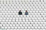 It's a coat and wooly hat day for spectators in the stands during the second day of play in the Specsavers County Champ Div 1 match between Hampshire County Cricket Club and Essex County Cricket Club at the Ageas Bowl, Southampton, United Kingdom on 28 April 2018. Picture by Graham Hunt.