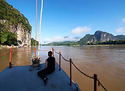 Laos. Luang Say Cruise on the Mekong, approaching Pak Ou Caves.