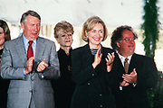 U.S. First Lady Hillary Clinton stands next to Journalist Robert MacNeil, left, and Music Director of the Metropolitan Opera James Levine, right, during the National Medal of Arts and Humanities awards during a ceremony on the South Lawn of the White House September 29, 1997 in Washington, DC.