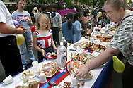Revellers enjoying a special buffet at a Golden Jubilee street party in Jubilee Street in the Stepney Green area of east London, where hundreds turned out to celebrate the 50 year reign of Queen Elizabeth II. Celebrations took place across the United Kingdom with the centrepiece a parade and fireworks at Buckingham Palace, the Queen's London residency. Queen Elizabeth ascended to the British throne in 1952 upon the death of her father, King George VI.