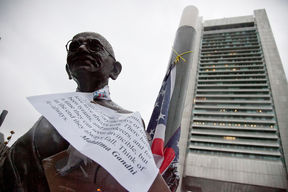 A statue of Mahatma Gandhi is seen in front of the Federal Reserve Bank building at Dewey Square, where Occupy Boston set up  tents in Boston, Massachusetts, October 29, 2011.