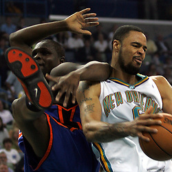 New Orleans Hornets center Tyson Chandler (right) pulls a rebound down against New York Knicks forward Zach Randolph (left) in the second quarter of their NBA game on April 4, 2008 at the New Orleans Arena in New Orleans, Louisiana.