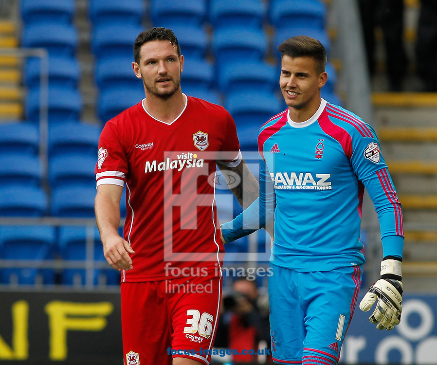 Sean Morrison of Cardiff City and Stuart Pearce of Nottingham Forest during the Sky Bet Championship match at the Cardiff City Stadium, Cardiff<br /> Picture by Mike  Griffiths/Focus Images Ltd +44 7766 223933<br /> 18/10/2014
