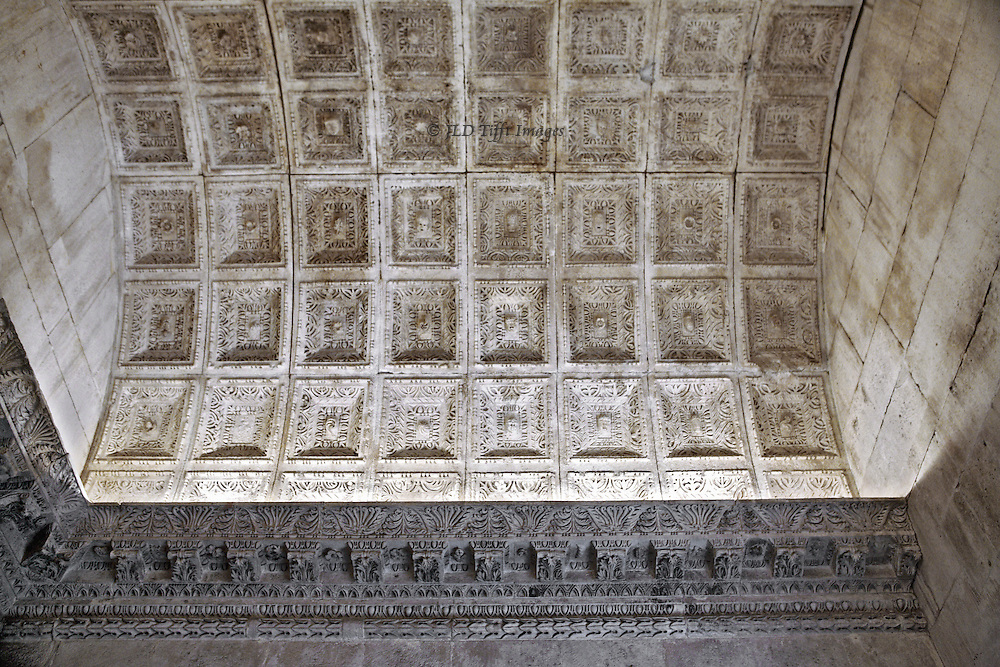 Looking up at the coffers, each carved with miniature heads and rosettes surrounded by egg-and-dart motifs.