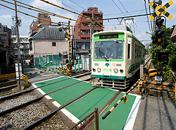 Small railway train on the Arakawa Railway in Tokyo which is the last tram route in Tokyo Japan 2008