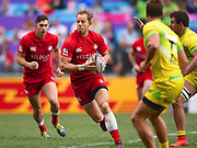 Canada player Harry Jones looks to pass the ball during the game Canada vs Australia during the Cathay Pacific/HSBC Hong Kong Sevens festival at the Hong Kong Stadium, So Kon Po, Hong Kong. on 7/04/2018. Picture by Ian  Muir.