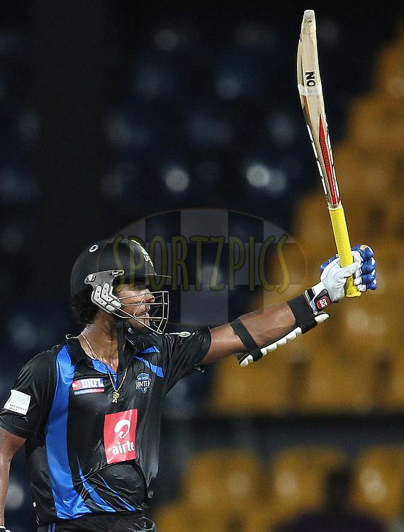Dinesh Chandimal of Wayamba United raises his bat after reaching his fifty during match 20 of the Sri Lankan Premier League between Ruhuna Royals and Wayamba United held at the Premadasa Stadium in Colombo, Sri Lanka on the 26th August 2012. .Photo by Shaun Roy/SPORTZPICS/SLPL