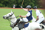 The Princes attended and played in a charity polo day<br /> Pictures show the Princes jockying for the polo Ball and harry messing around .with his feet in his styrupps aloft with william next to him with an endearing look.<br /> ©Exclusivepix Media