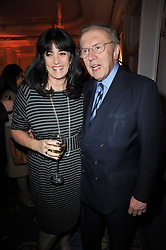 DAME GAIL REBUCK Chairman and Chief Executive of The Random House Group and SIR DAVID FROST at the 38th Veuve Clicquot Business Woman Award held at Claridge's, Brook Street, London W1 on 28th March 2011.