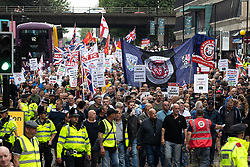 © Licensed to London News Pictures . 02/06/2018. Manchester, UK . Approximately 1,000 DFLA supporters march along Oxford Road in Manchester City Centre . The Democratic Football Lads Alliance demonstrate in Manchester , eleven days after the first anniversary of the Manchester Arena terror attack . Photo credit : Joel Goodman/LNP