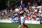 Fleetwood Town defender Cian Bolger (12) and AFC Wimbledon striker Joe Pigott (39) during the EFL Sky Bet League 1 match between Fleetwood Town and AFC Wimbledon at the Highbury Stadium, Fleetwood, England on 4 August 2018. Picture by Craig Galloway.