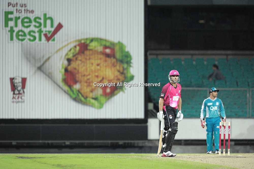 16.12.2011 Sydney, Australia.The sponsors get some airtime on the sight screen during the KFC T20 Big Bash League game between Sydney Sixers and Brisbane Heat at the Sydney Cricket Ground.