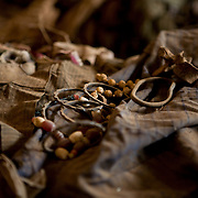 A massacre victim's jewellery pieces sit atop clothing piles,  Nyamata Church memorial