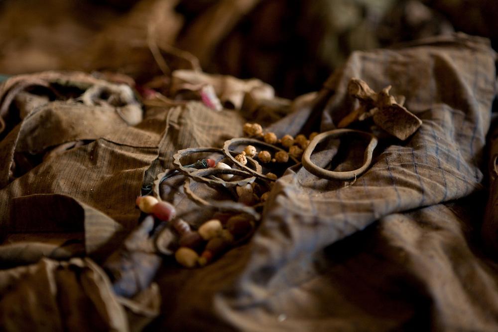 A massacre victim's jewellery pieces sit atop clothing piles,  Nyamata Church memorial