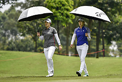 October 26, 2017 - Kuala Lumpur, Malaysia - Eun Hee Ji(L) of South Korea , Jennifer Song(R) os USA during day one of the Sime Darby LPGA Malaysia at TPC Kuala Lumpur East Course on October 26, 2017 in Kuala Lumpur, Malaysia. (Credit Image: © Chris Jung/NurPhoto via ZUMA Press)