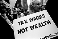 Demonstrators with signs mocking Tax system, New York City, 2004