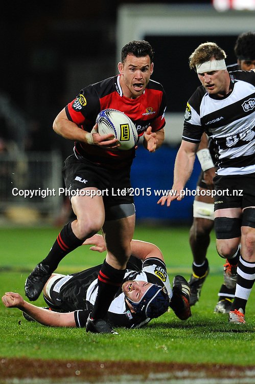 Ryan Crotty of Canterbury eludes Mark Abbott of Hawkes Bay  during the ITM Cup rugby match, Canterbury v Hawke's Bay, at AMI Stadium, Christchurch, on the 12th September 2015. Copyright Photo: John Davidson / www.photosport.nz