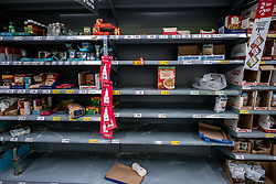 © Licensed to London News Pictures. 05/03/2020. London, UK. Empty shelves on the home baking aisle. Panic-buying continues to show in a South West London ASDA store as shelves empty out of goods as Prime Minister Boris Johnson appears on This Morning TV show to reassure the public that the Government is doing all it can to fight the coronavirus disease.. Photo credit: Alex Lentati/LNP